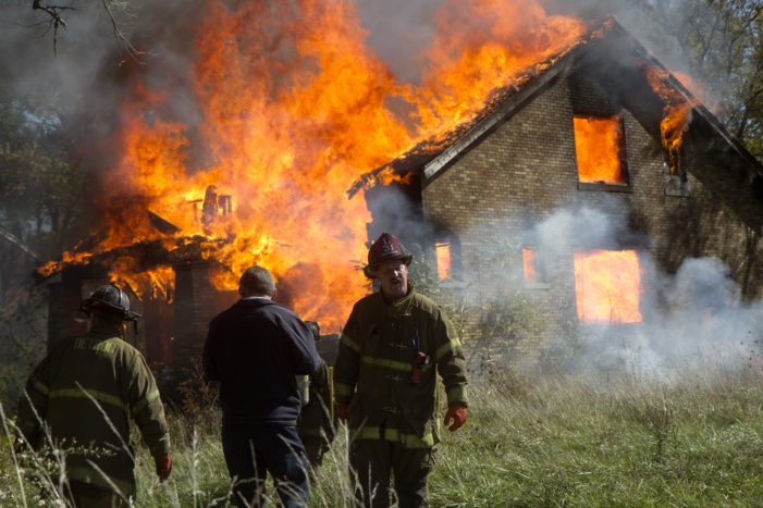 In one afternoon, Detroit firefighters struggle against residents, fires and budget cuts
