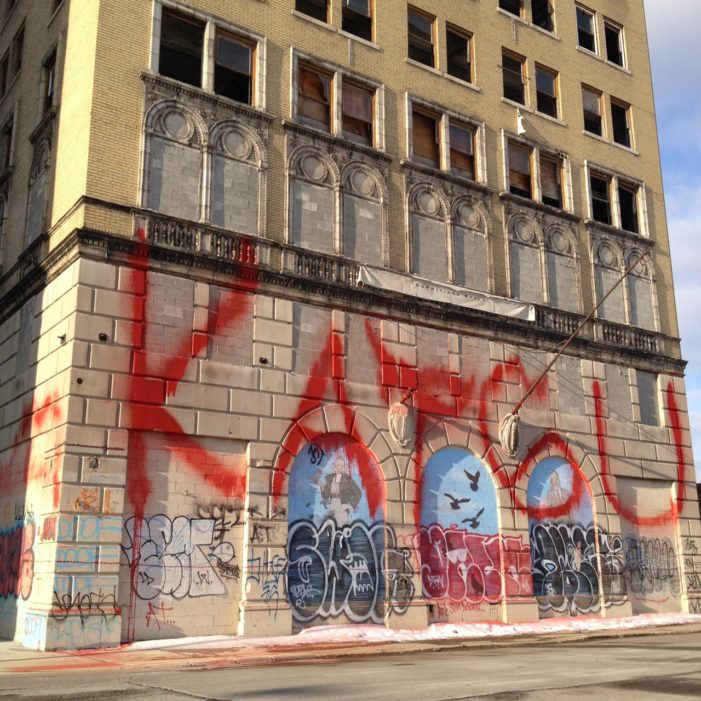 Controversial graffiti writer from New York City splashes Detroit with fire extinguisher-propelled paint