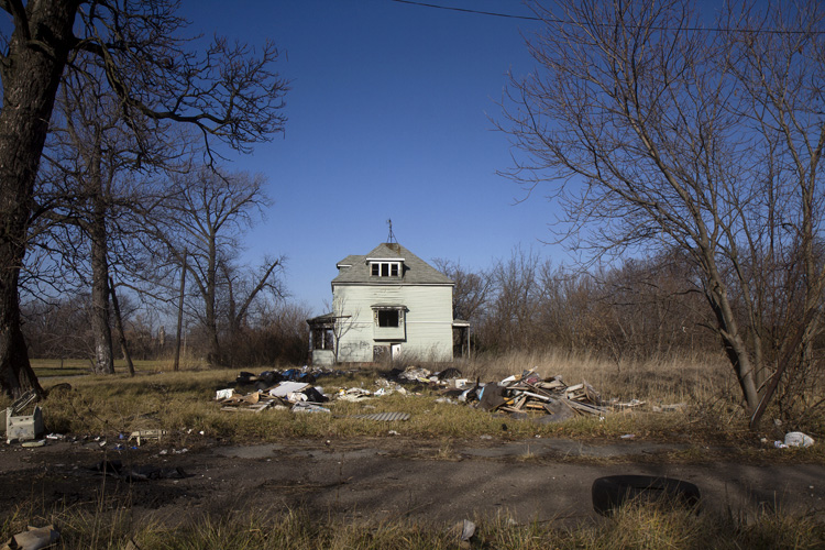 Abandoned houses often are alone, the last standing on the block.