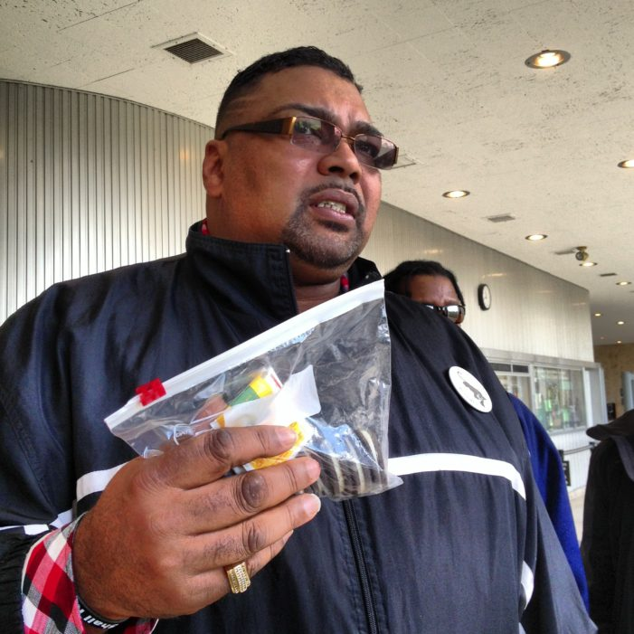 Black religious leader, protesters hand-deliver Oreo cookies to Detroit officials