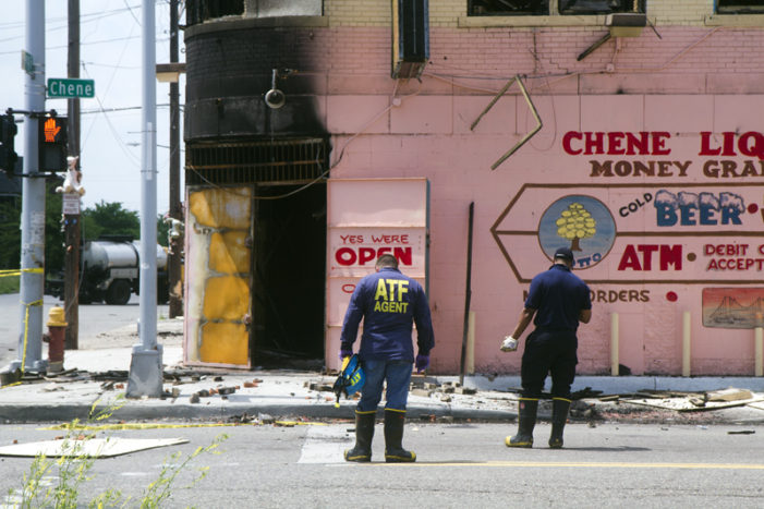Tense scene unfolds outside charred liquor store as ATF investigates, scrappers lurk