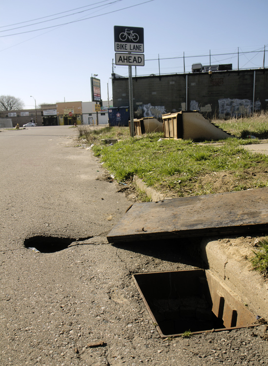 A Detroiter fell into this open sewer hole in April 2013.