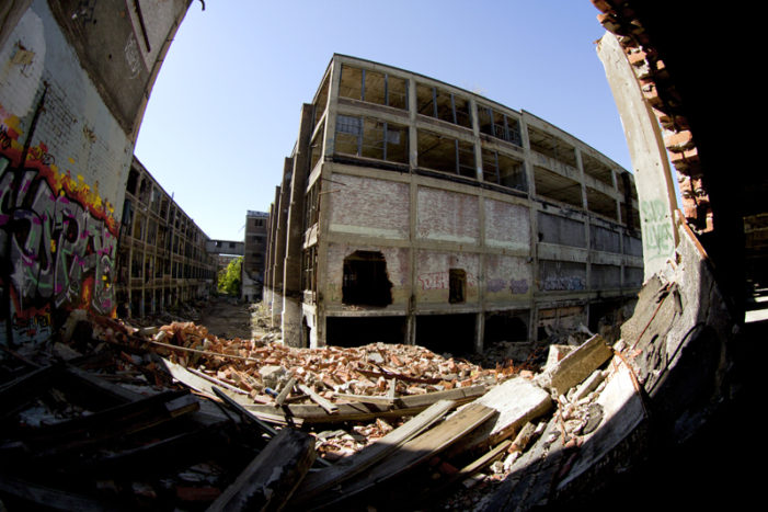 Works begins on restoring long-neglected Packard Plant, iconic bridge