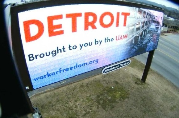 Billboards depict Detroit as industrial wasteland ruined by UAW