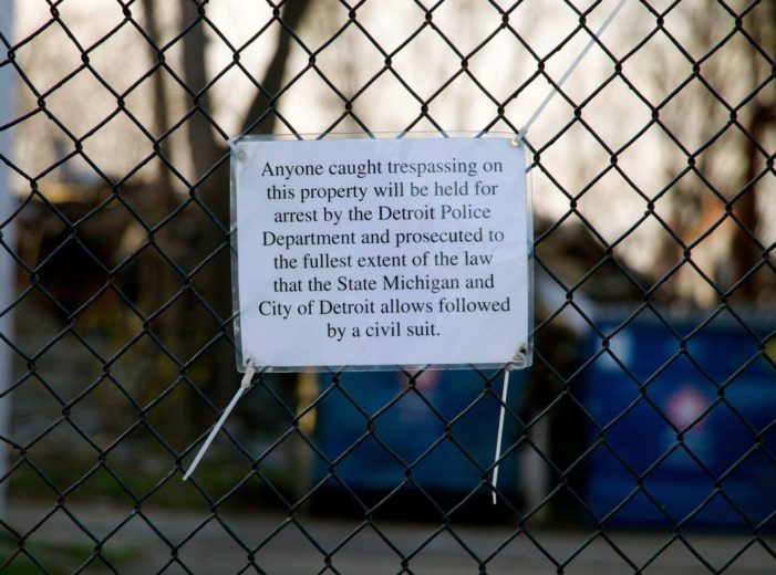 Busted! Chicago-area investor forced to stop scavenging vacant building in Detroit