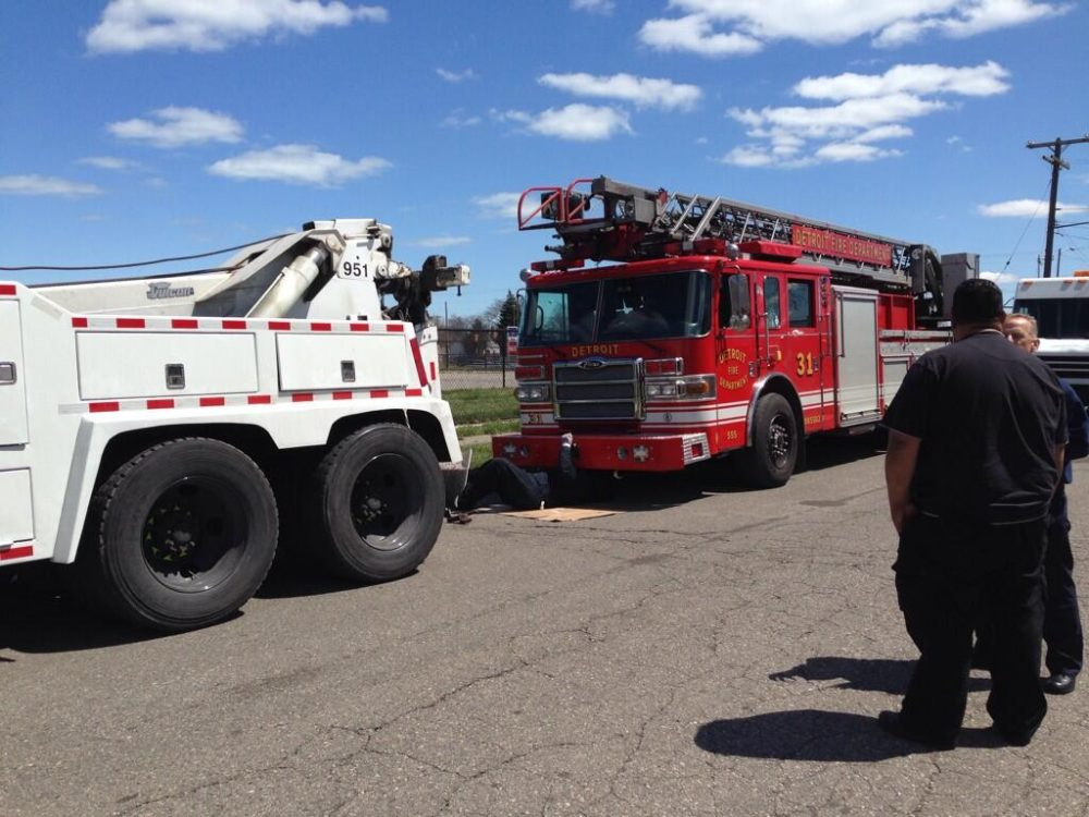 Ladder 31 gets towed away.