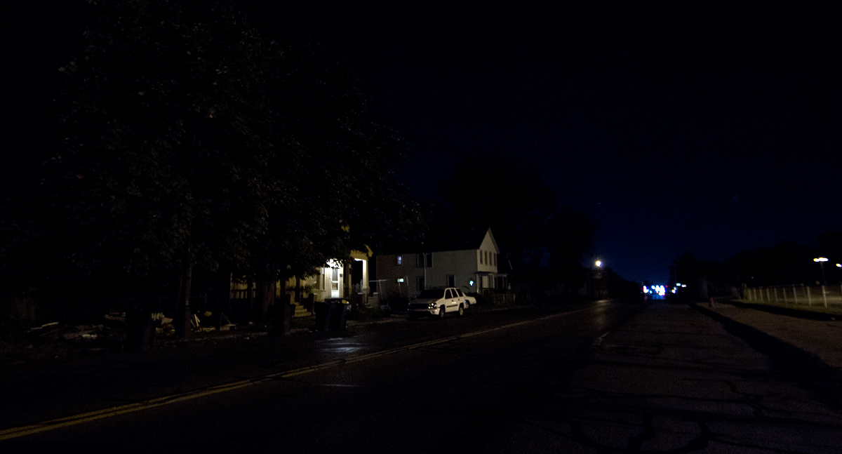 This street off of Mack Avenue is dark except for a porch light.