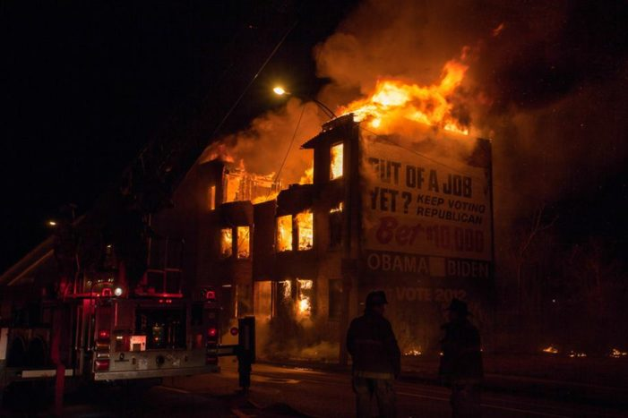Fire guts apartment building known for enormous Obama ad off I-75 in Detroit