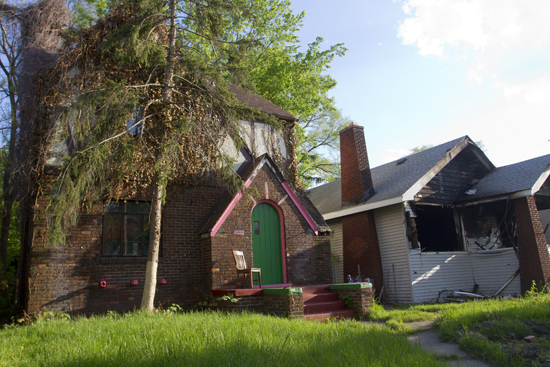 A rare occupied house on this block of W. Robinwood narrowly escaped damage when the neighboring home was burned on May 20.