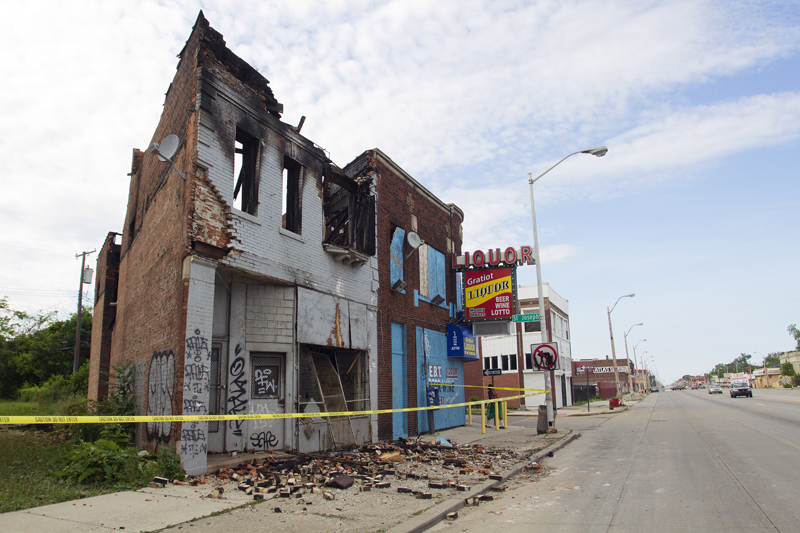 Suspicious fire gutted this vacant commercial building on Gratiot near Mack. Photos by Steve Neavling.