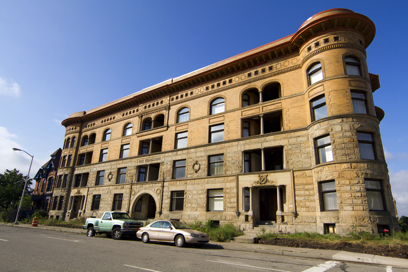 The Coronado was built in the 1890s for the affluent middle class. The Richardsonian Romanesque building now serves low-income residents.