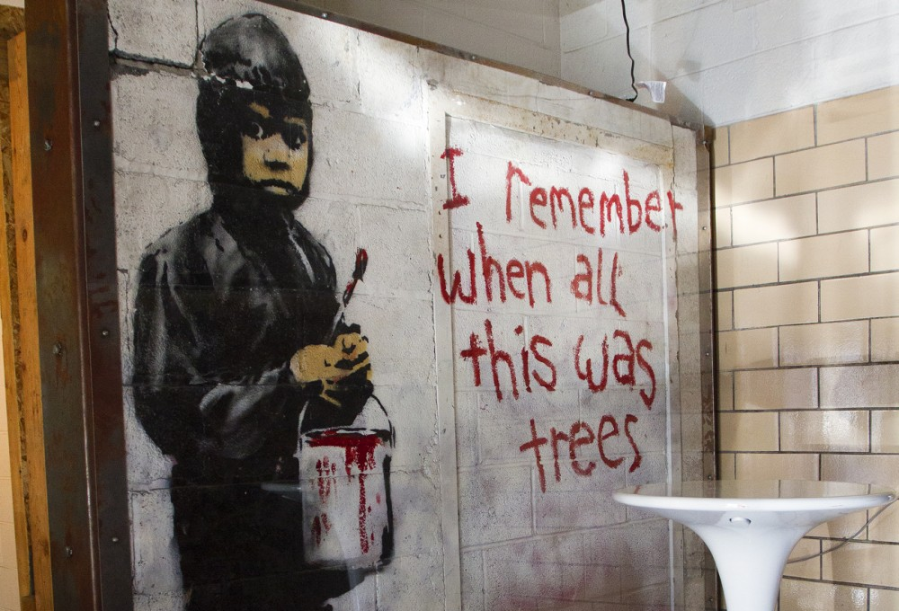 Banksy mural at 555 Gallery. By Steve Neavling.