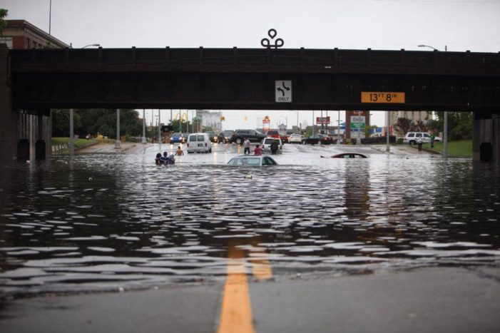 Flooding submerges dozens of cars, closes highways, impedes firefighters in Detroit