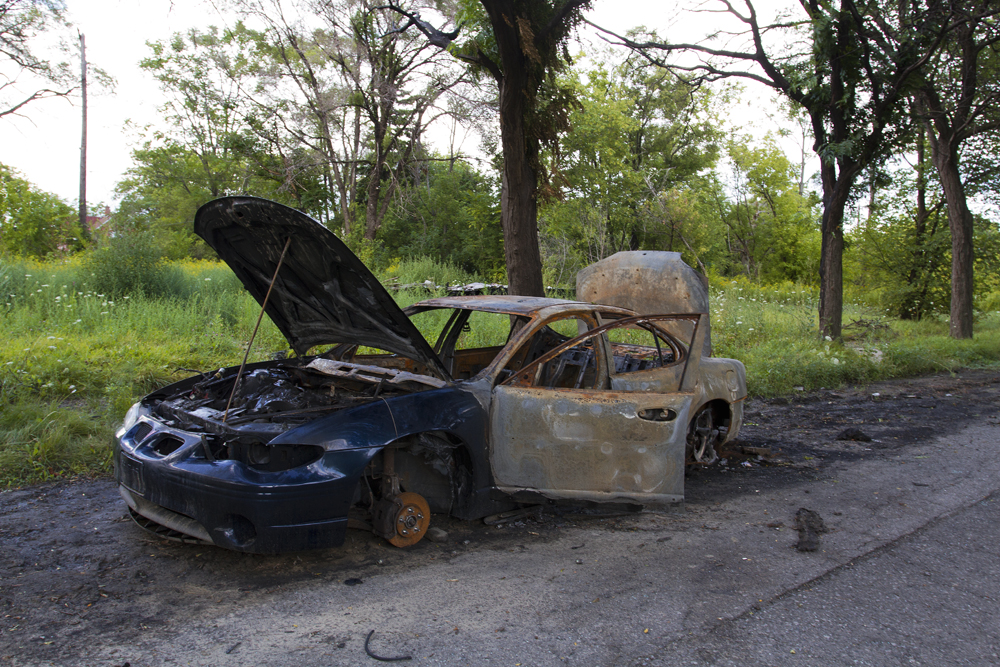 The city has let this burned car for the scrappers.