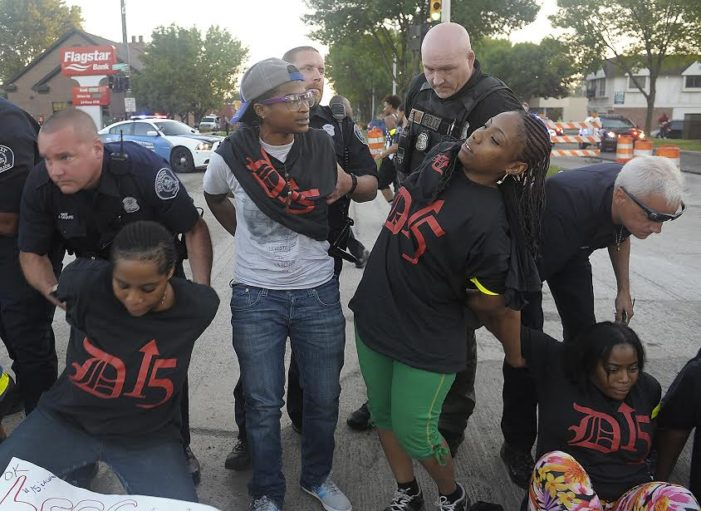Dozens of fast-food workers arrested at protest in Detroit, Grosse Pointe