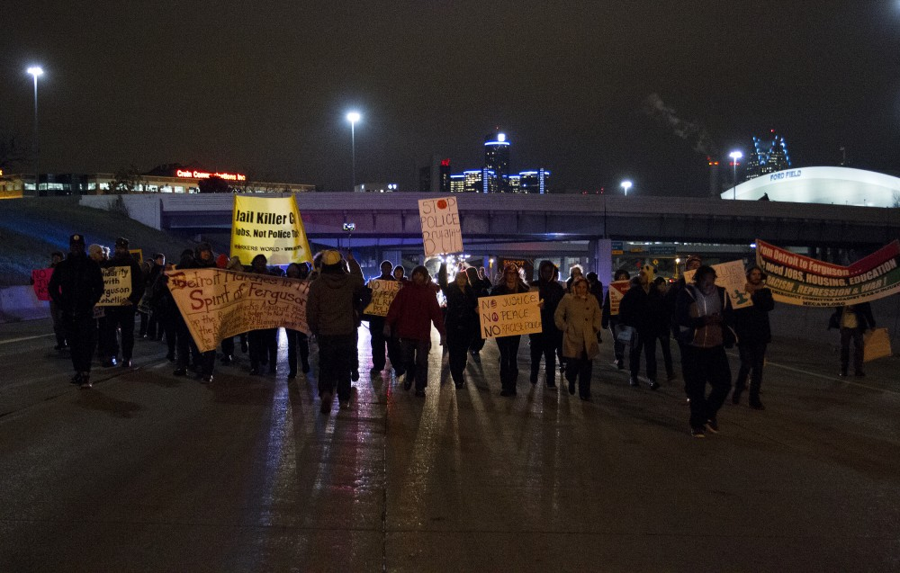 Protesters march north on I-75 in Detroit. Photo by Steve Neavling