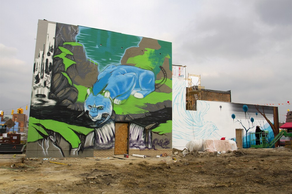 Two murals-in-progress from Kobie Solomon (left) and Malt (right).
