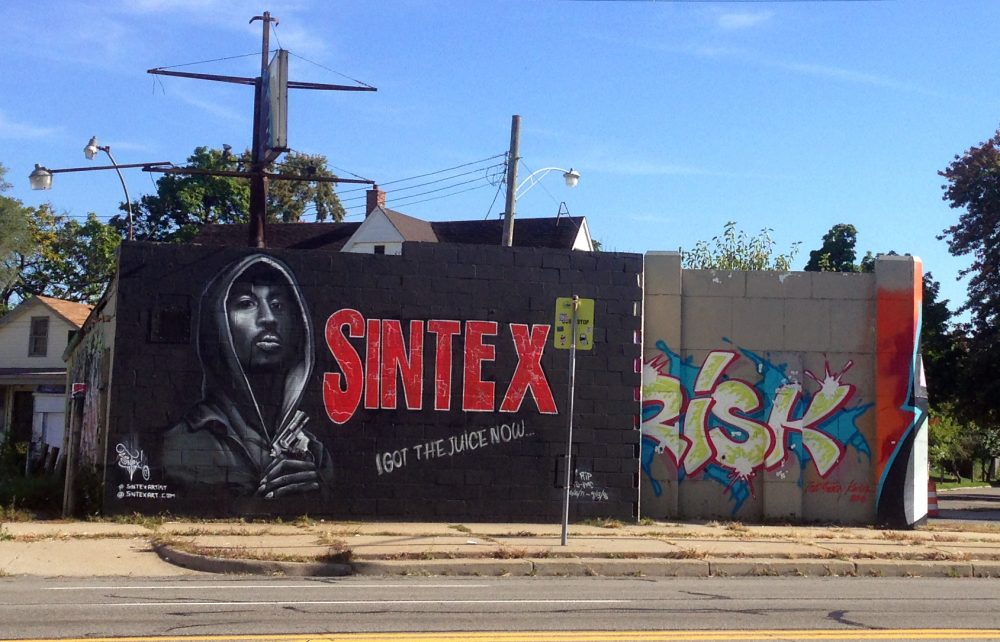 Detroit artist Sintex painted this image of Tupac over a mural by LA artist Revok.