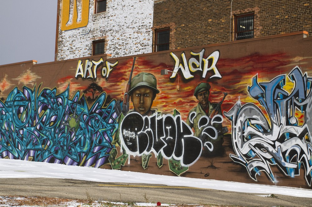 "The word ""Revok"" is painted over Sintex's ""Art of War"" mural."