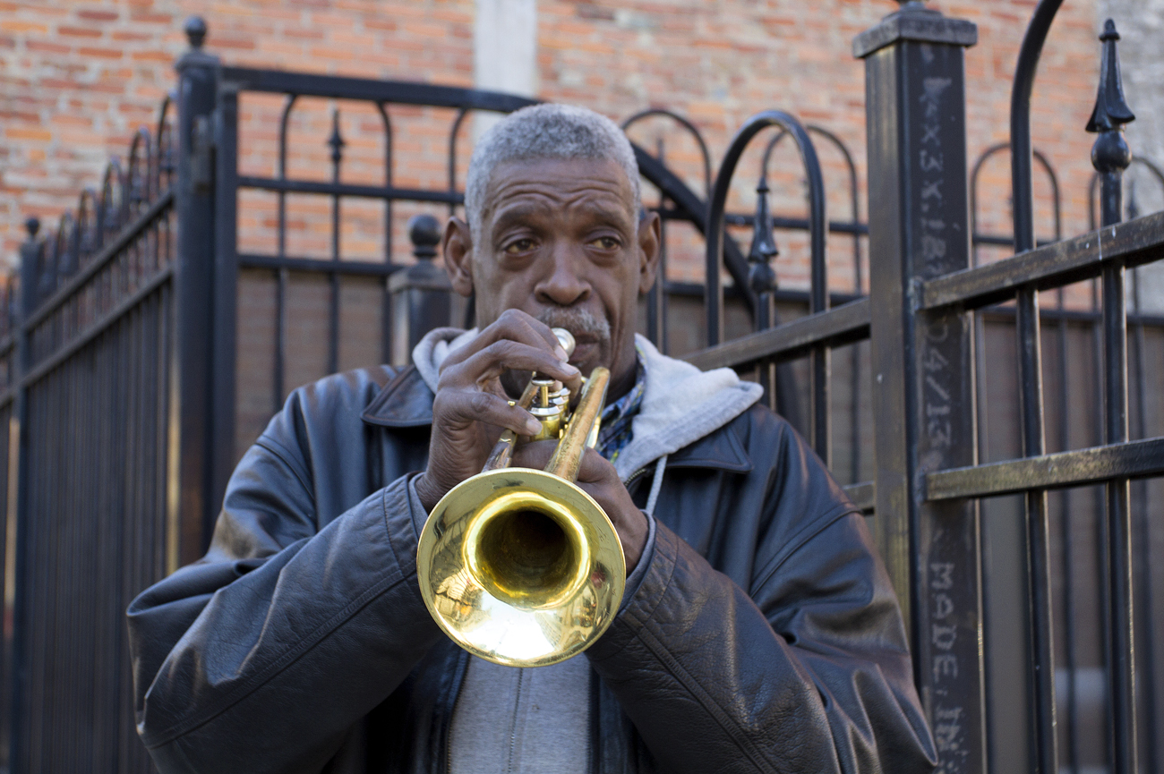 Frank McCullers, 53, plays trumpet outside of the Opera House in downtown Detroit. Photo by Steve Neavling.