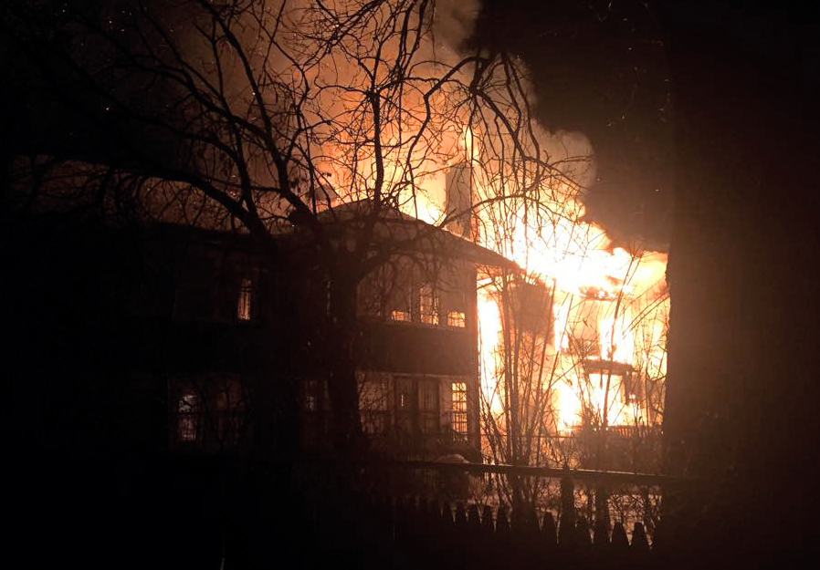 Flames consumed a stately home on W. Chicago. Photo by Michael Evans .