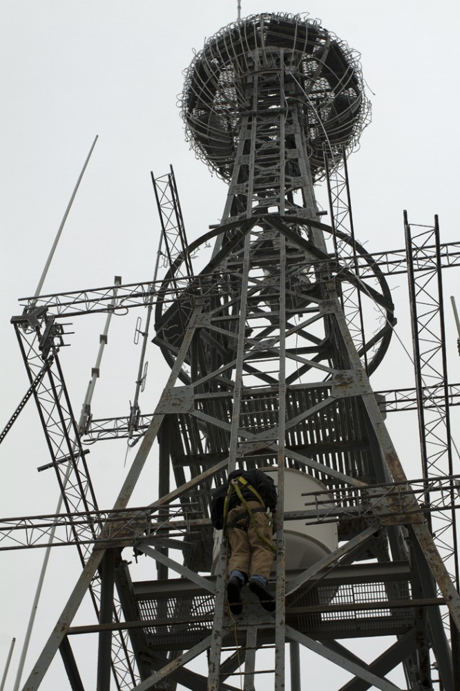 Todd Farnum climbs the icy, narrow steps of the tower on Wednesday.