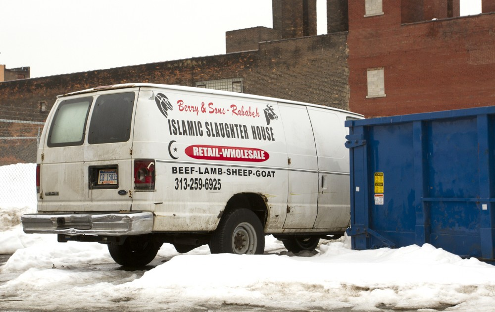 Berry and Sons Islamic Slaughter House van beside the carcass-filled dumpster in Eastern Market. Steve Neavling/MCM
