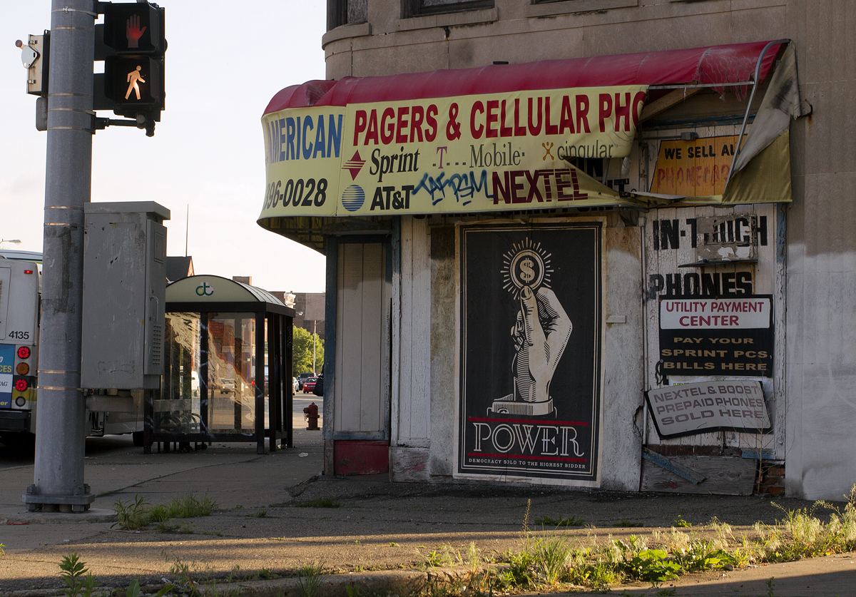 A Fairey mural mocking consumerism and power was posted on a vacant building on Gratiot. By Steve Neavling/MCM