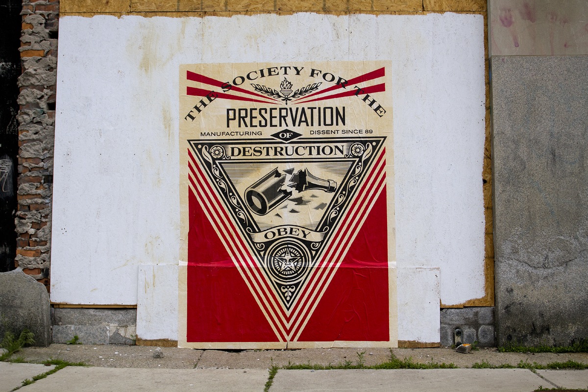A Fairey mural posted on the CPA Building on Michigan Avenue across from the Michigan Central Station.