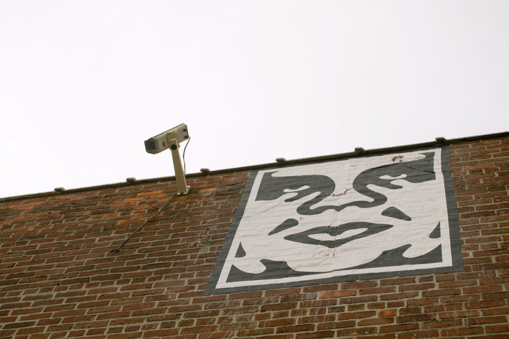 Andre the Giant image beside a surveillance camera at the Eastern Market. Photo by Steve Neavling/MCM.