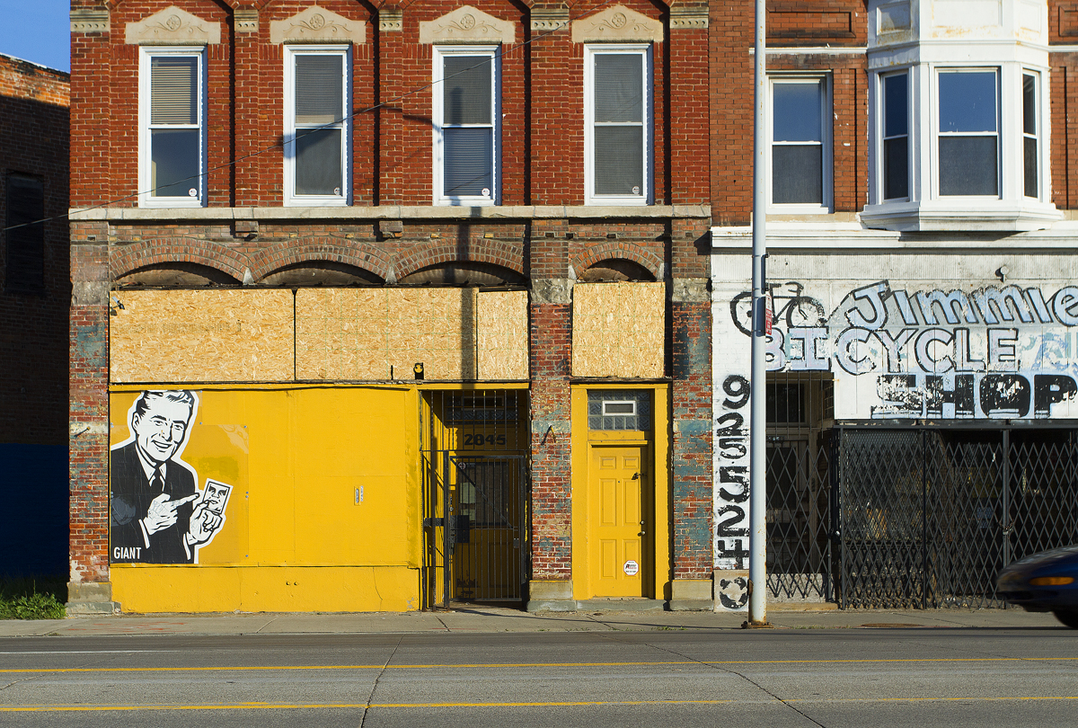A Fairey mural on a vacant building on Gratiot.