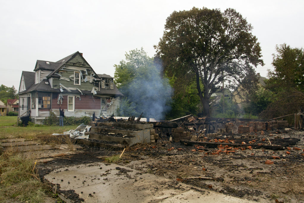 A fire flattened a house on Cutler and damaged two occupied homes. Photo by Steve Neavling.