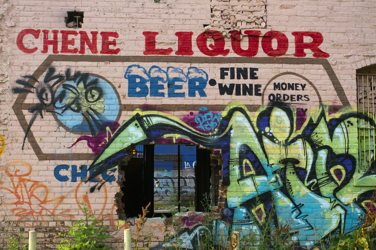 A fire-gutted building on Chene in Detroit is riddled with graffiti.