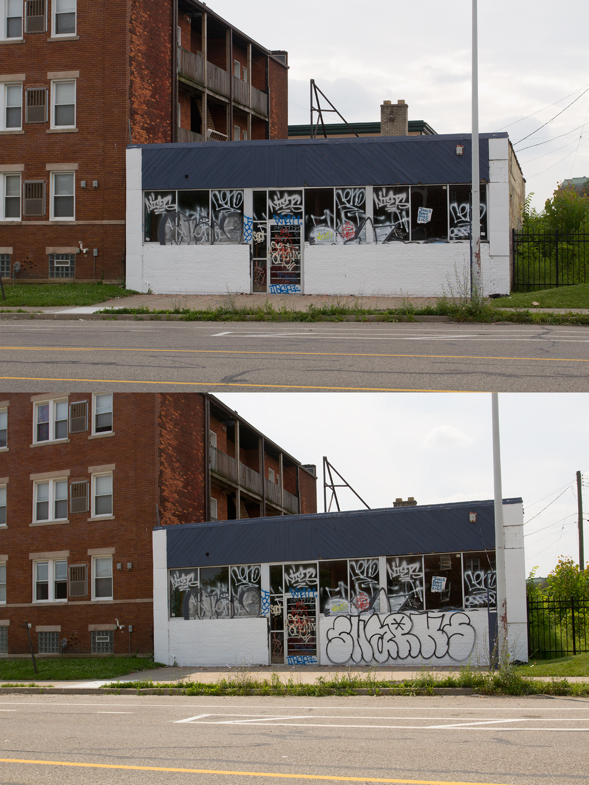 A day after a property owner painted over graffiti on this Cass Corridor building, vandals struck it again.