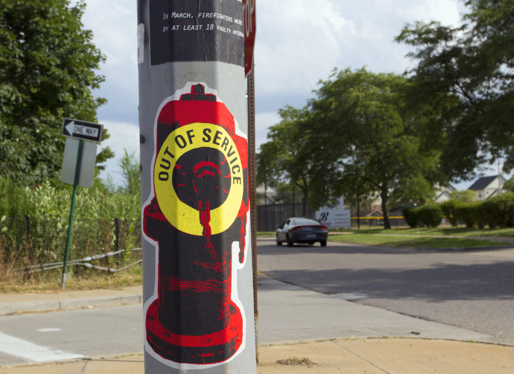 A broken hydrant poster is pasted on a light pole in Detroit. Photo by Steve Neavling.