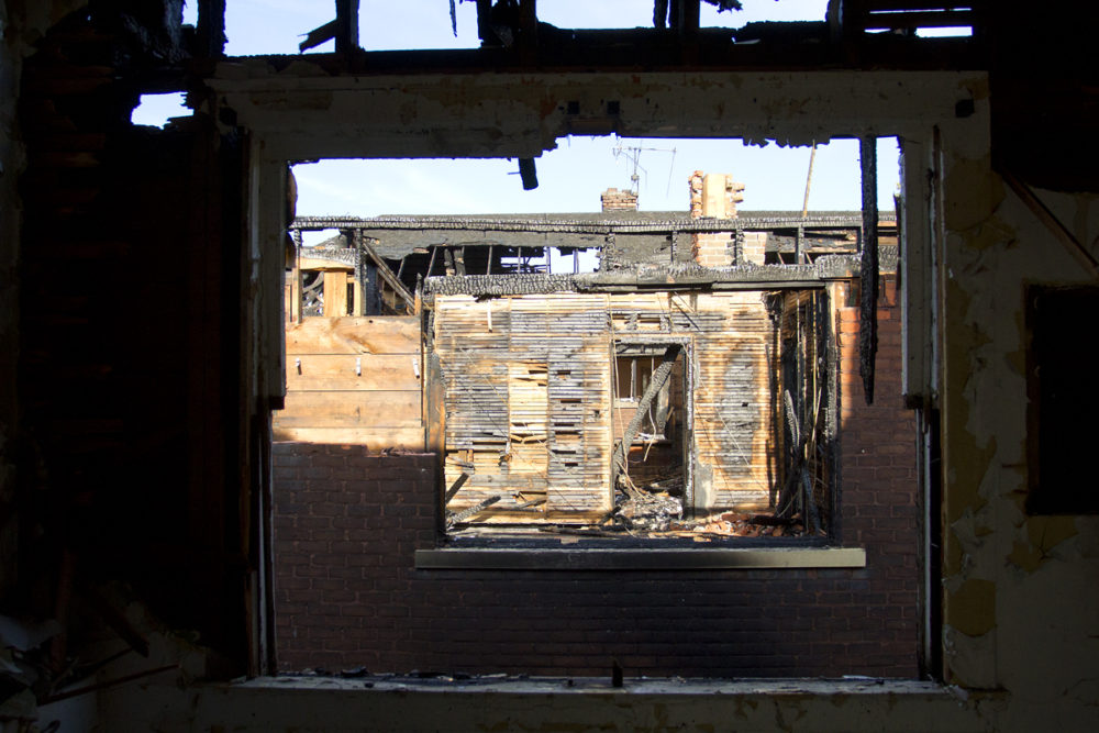 Through the window of one of the fire-damaged houses on Monterey.