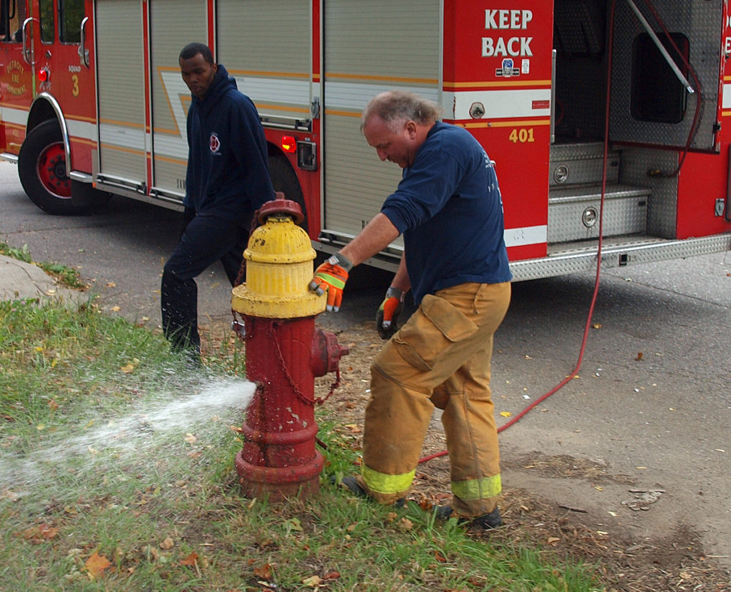 Firefighter Mike Nevin inspects a fire hydrant. Photo courtesy of the Detroit Fire Department.