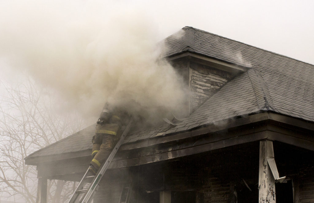 Extinguishing a fire in a vacant house on the east side.