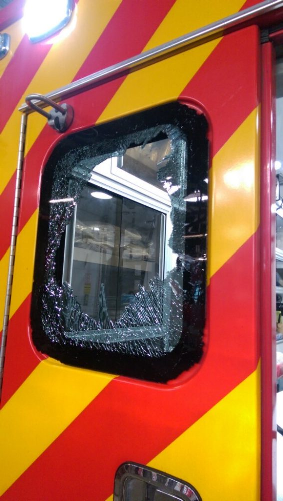 The radio was thrown through this window. Photo courtesy of Detroit Fire Department.