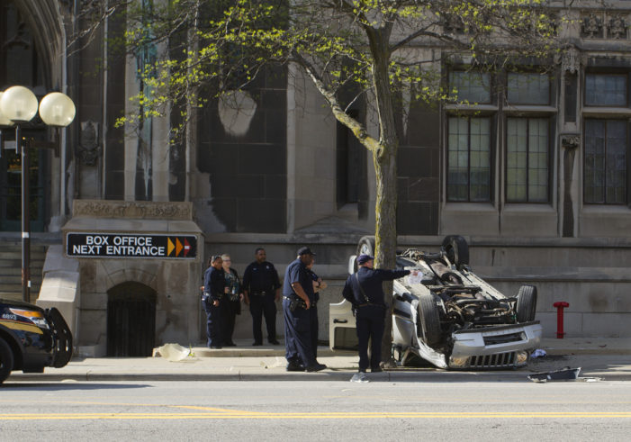 SUV full of high school students flips over, nearly strikes Masonic Temple in Detroit