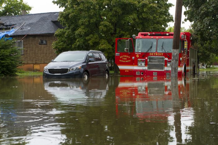 17 photos: Torrential rain stranded motorists, turned streets into rivers