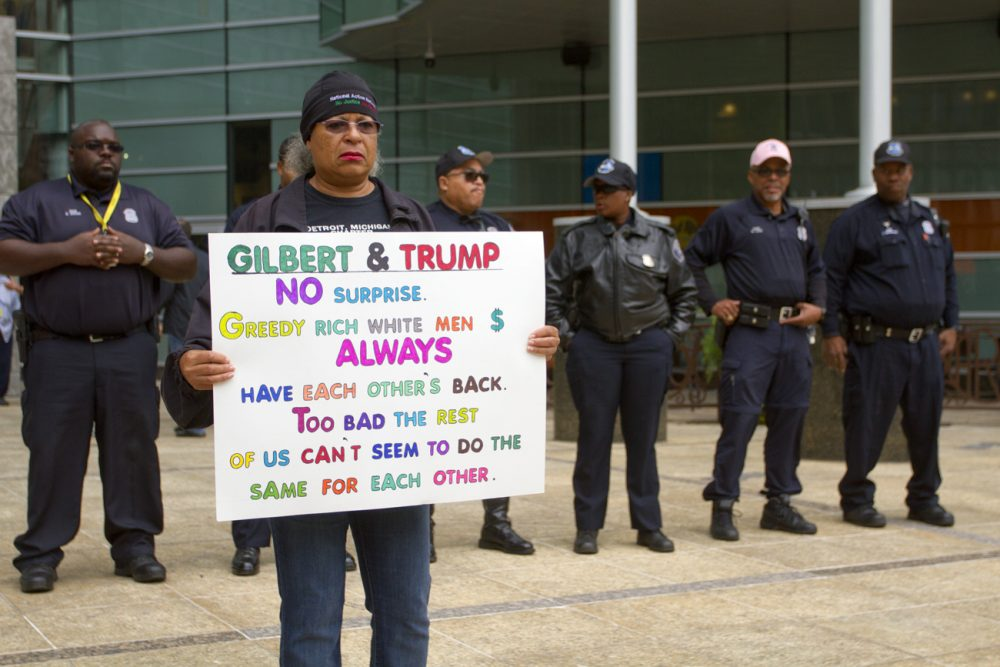Protesters gathered outside of Dan Gilbert's Quicken Loans headquarters to rally against the fundraiser.