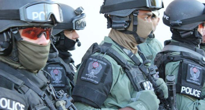 Video: Feds with military fatigues, assault rifles swarm Detroit home