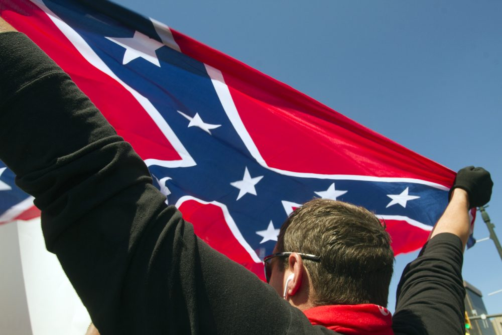 A Trump supporter held up the Confederate flag when the Republican candidate was in Detroit. Photo by Steve Neavling.