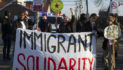 13 photos of pro-immigration rally outside a Detroit ICE office